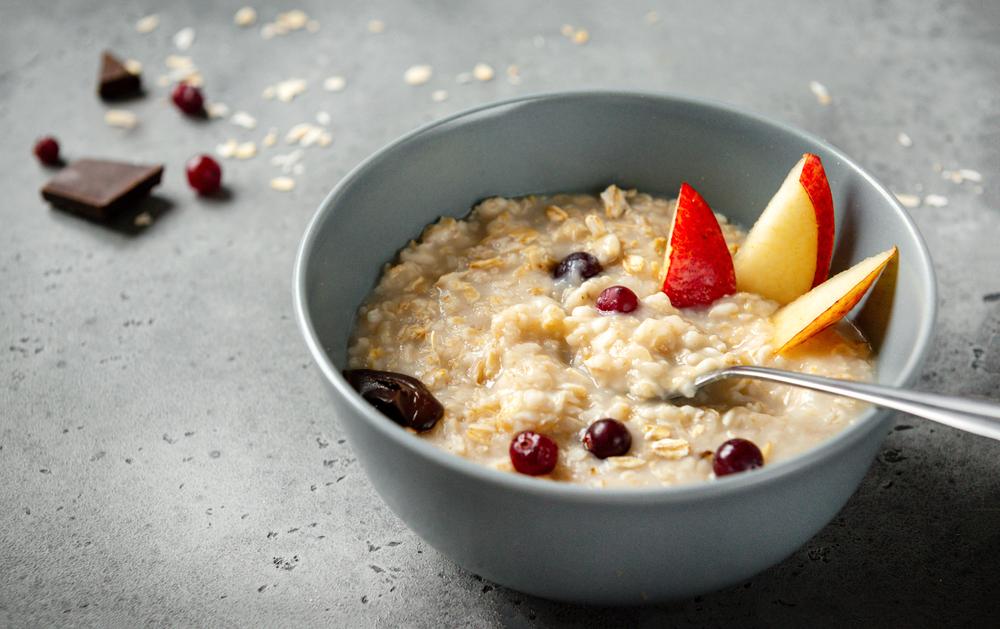 Oatmeal,Porridge,With,Pieces,Of,Fruit,,Pear,,Berries,,Orange,,On